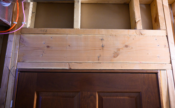 Stud-framed wall with double header