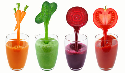 vegetable juices in a dripping glass isolated on white