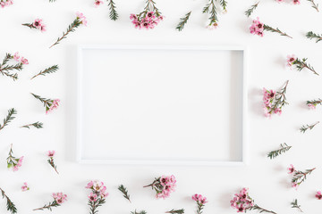 Beautiful flowers composition. Blank frame for text, pink flowers on white background. Valentines Day, Easter, Birthday, Happy Women's Day, Mother's day. Flat lay, top view, copy space