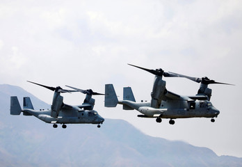 Two Osprey aircrafts are flown during the amphibious landing exercises of the U.S.-Philippines war games promoting bilateral ties at a military camp in Zambales province