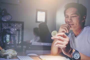 Happy businessman holding bitcoin money. Digital money concept