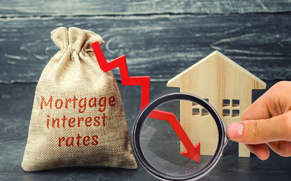 Bag with the money and the word Mortgage interest rates and arrow to down and house. Low interest in mortgages. Reducing interest payments for mortgages. The fall in housing rates on credit.