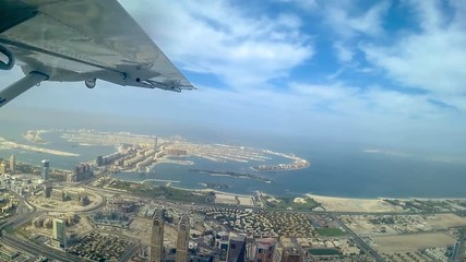Wall Mural - Aerial view of Dubai from plane with Palm Jumeirah island - Video HD