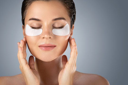Woman with hydrating eye patches under her eyes o