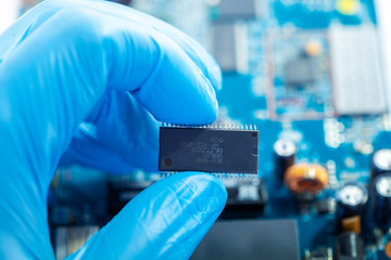 Microprocessor in the hands of a scientist