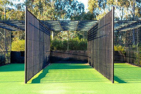 A cricket practice net on green grass in Melbourne, Victoria, Australia