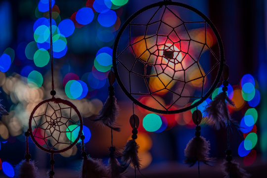 Lovely mystical dream catchers silhuettes on vibrant blue and green bokeh background