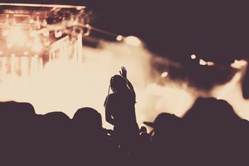 Deurstickers Aquarel Gezicht cheering crowd with raised hands at concert - music festival