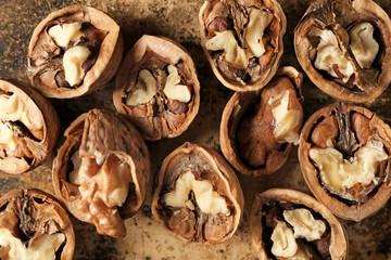 In de dag Baobab Tasty walnuts on color background