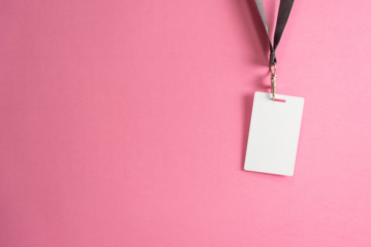 Proximity or RFID card for control security, access, protect on pink background.