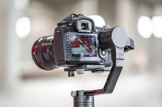 Professional digital equipment recording presentation for website, focus on camera