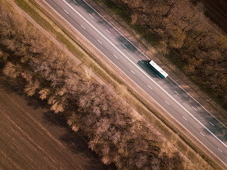 Aerial Top View of Truck with Cargo Semi Trailer Moving on Road in Direction