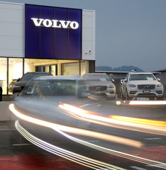 A long exposure picture shows cars of Swedish automobile manufacturer Volvo displayed in front of a showroom of Stierli Automobile AG company in St. Erhard