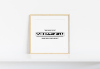 Square Wooden Frame on White Shelf Mockup