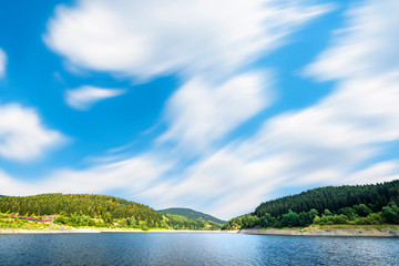 Large lake under a blue sky in the wind
