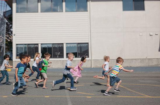 Running preschool kids outside