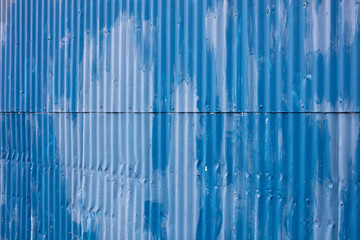 Painted blue warehouse wall