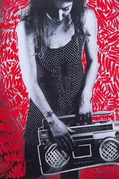Low res print with chalk drawings of ghetto blaster held by a cool young woman with tattoos