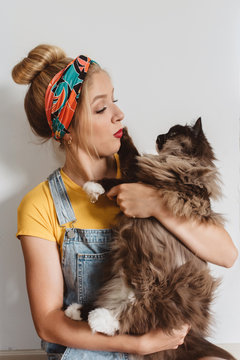 A young woman at home with her cat