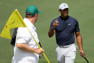 Tiger Woods of the U.S. holds his ball after putting on the second green during first round play of the 2019 Masters golf tournament at Augusta National Golf Club in Augusta, Georgia, U.S.