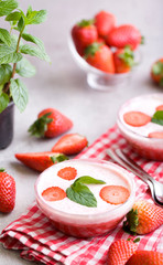 Delicious strawberry mousse with whipped cream.