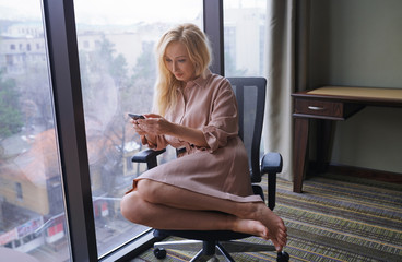 Woman at the office using smartphone
