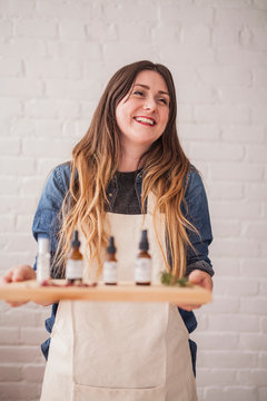 Home business owner with her essential oils on a platter