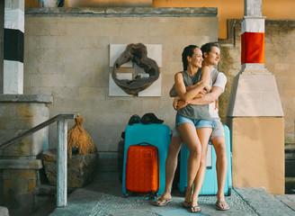 couple sitting on luggage