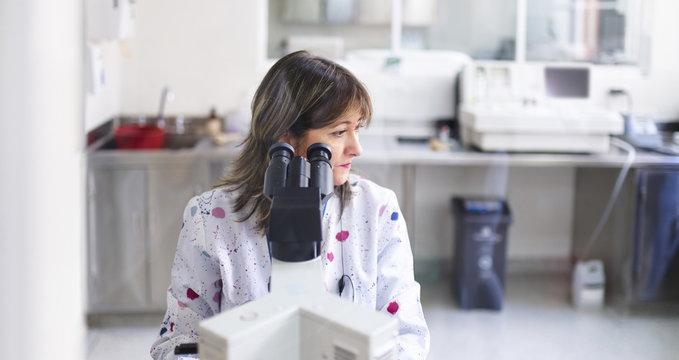 Laboratory professional doing a microscope analysis