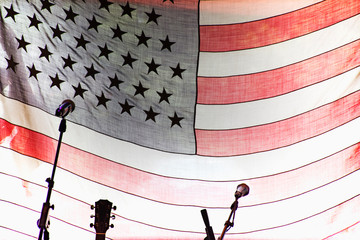 Microphones and guitar by American Flag