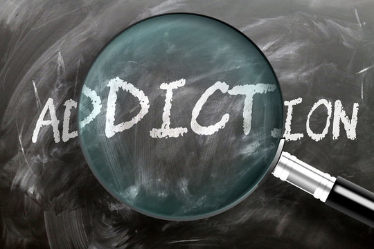 Learn, study and inspect addiction - pictured as a magnifying glass enlarging word addiction, symbolizes researching, exploring and analyzing meaning of addiction, 3d illustration