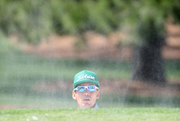Rafael Cabrera Bello of Spain watches his ball during first round play of the 2019 Masters golf tournament at Augusta National Golf Club in Augusta, Georgia, U.S.