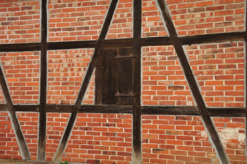 closed window in brick facade of an old barn