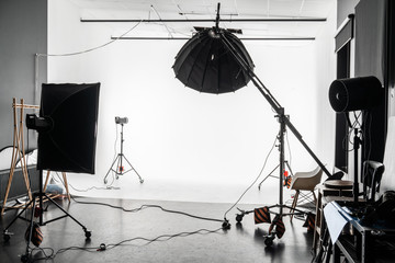 empty photo Studio with white cyclorama. Monoblocks with flashes using softboxes of different shapes. photographic studio space with white cyclorama