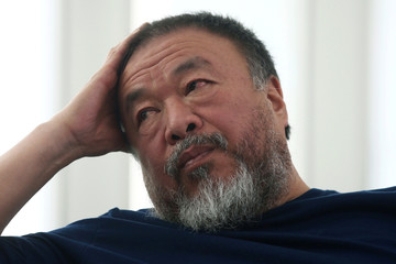 """Chinese artist Ai Weiwei gestures during a news conference for his exhibition """"Restablecer Memorias"""" displayed at MUAC in Mexico City"""