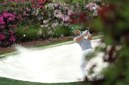 Rafael Cabrera Bello of Spain chips onto the 13th green during first round play of the 2019 Masters golf tournament at Augusta National Golf Club in Augusta, Georgia, U.S.