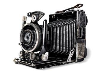 Old camera on white background, isolated.