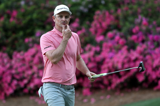 Justin Rose of England looks over the 13th green during first round play of the 2019 Masters golf tournament at Augusta National Golf Club in Augusta, Georgia, U.S.