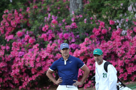 Brooks Koepka of the U.S. looks over the 13th green during first round play of the 2019 Masters golf tournament at Augusta National Golf Club in Augusta, Georgia, U.S.