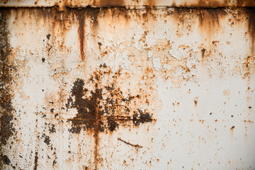 Rusty metal textured background with chipped white paint. Old rough rusted grungy surface Wall mural