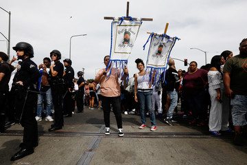 LAPD officers reopen a path for the funeral procession after fans filled the intersection while waiting for the procession following a memorial for rapper Nipsey Hussle in Los Angeles