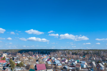 Aerial drone view of an old traditiona village in the forest, on background bly sky.