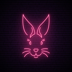 Rabbit neon sign. Pink easter bunny muzzle. Vector illustration.