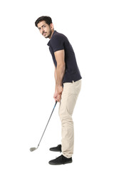 Smart young boy with playing golf stick. Isolated on white background.