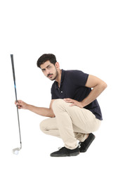 Smart boy  is sitting with golf stick in hand and golf ball. Isolated on white background.