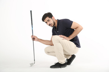 Picture of handsome boy sitting on the floor with golf stick in hand. Isolated on white background.