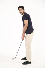 Handsome boy standing with golf stick and golf ball. Isolated on white background.