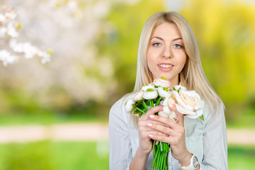 Beautiful young women with flowers