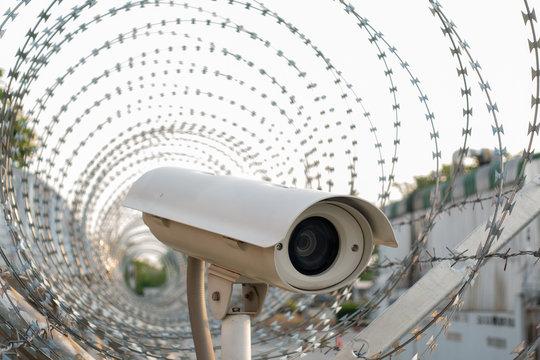surveillance camera in barbed wire