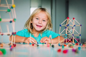 happy child making geometric shapes, engineering and STEM